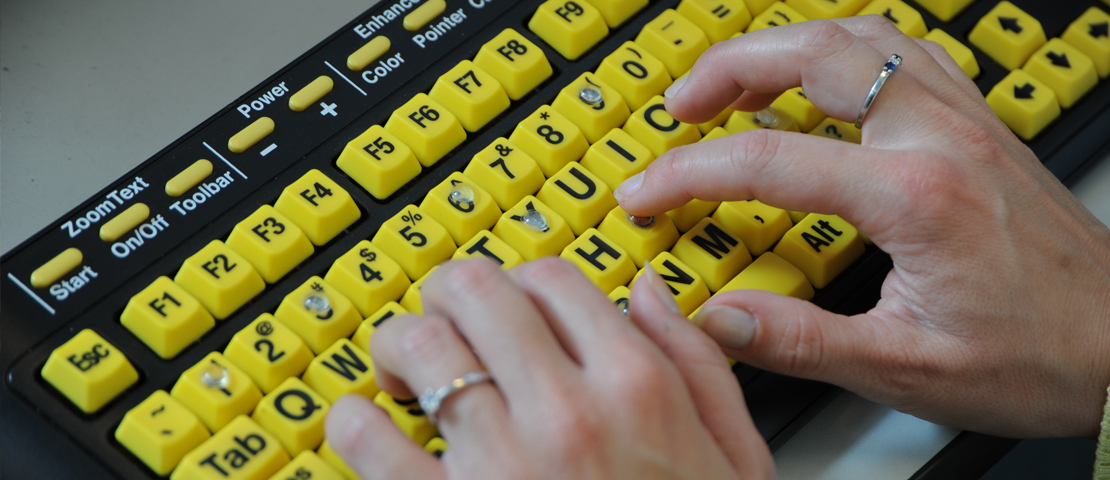 Hands on a keyboard with bumpons.