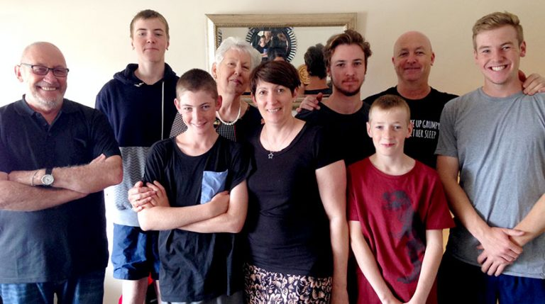 Tim with his close-knit family – his wife, daughter and five grandsons