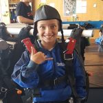 Nastacia posing in skydive gear