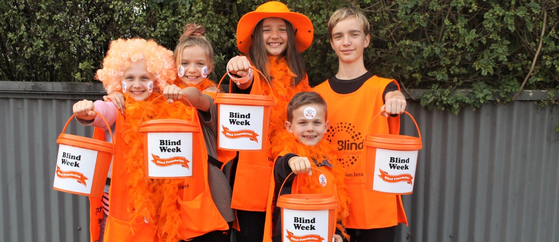Children dress up to help street collection on blind week