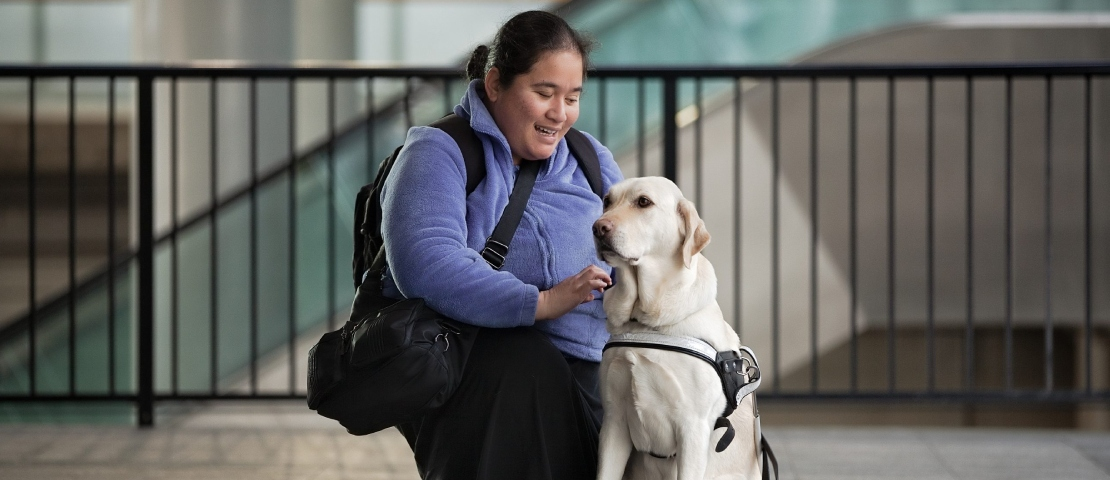 Guide dog handler with guide dog